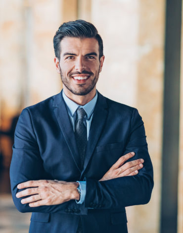 Businessman with arms crossed looking at camera